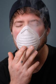Man Smoking Cigarette With Face Mask Stock Images