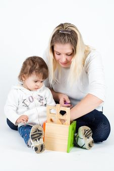 Free Mother And Little Daughter Playing With Puzzle Cub Stock Photos - 13688233