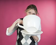 Young Girl About To Drink From Extra Large Cup Stock Photos