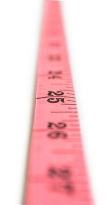 Free Measuring Tape Looking As Vertical Line Royalty Free Stock Photo - 13690185