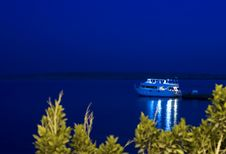 Motor Yacht Moored To Jetty At Night Stock Photos