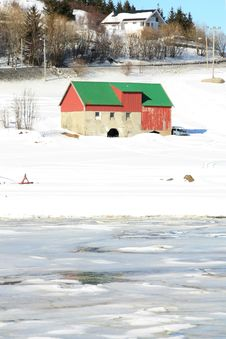 Hayloft And Icy Busknes  Fjord Stock Photography