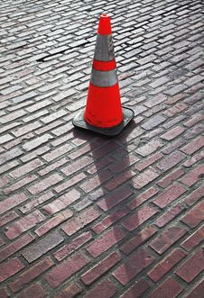Traffic Cone On Brick Street Royalty Free Stock Photography