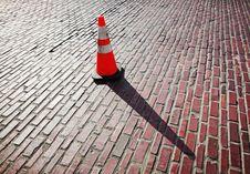 Traffic Cone On Brick Street Stock Photo