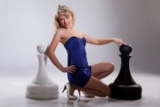 Free Young Blonde Woman And Chessmen Stock Images - 13693224