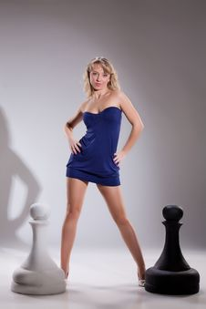 Free Young Blonde Woman And Chessmen Stock Photography - 13693232