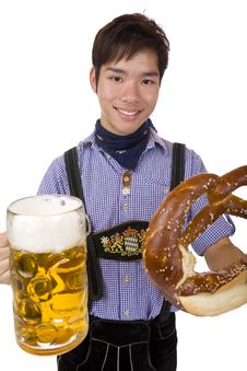 Free Man Holds Oktoberfest Beer Stein And Pretzel Stock Images - 13694454