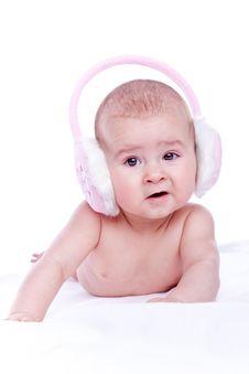 Free Happy Baby With Pink Fur Headphones Stock Photo - 13696380