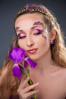 Free Beautiful Girl Holding Purple Iris Stock Photos - 13696603