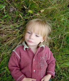 Free Portret Little Girl On Grass. Royalty Free Stock Photos - 13696628