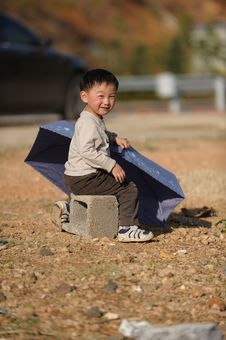 Free Asian Boy And Umbrella Stock Photo - 13698280