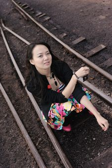 Asian Girl Sit On Rail Royalty Free Stock Photo