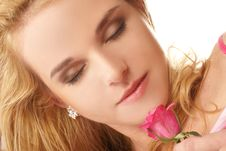 Portrait Of A Blond With A Pink Rose Stock Photo