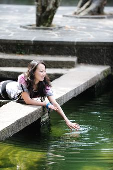 Free Chinese Girl By Water Royalty Free Stock Images - 13698779