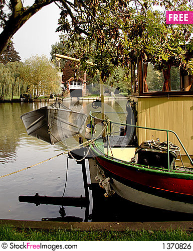 Boat Moored on a Riverbank Stock Photo