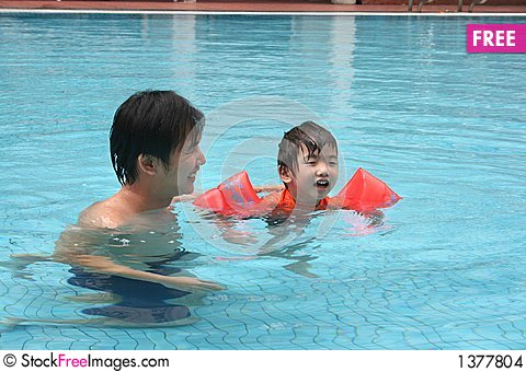 Man & boy in the pool Stock Photo