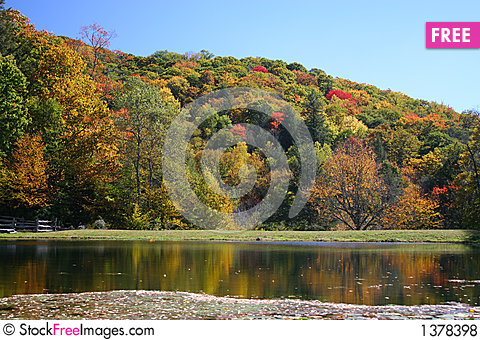 Colorful fall foilage on hills Stock Photo