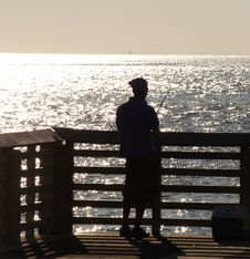 Free Fisherman At The Pier Royalty Free Stock Photos - 1370208
