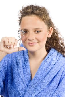 Free Young Woman Dressed Blue Bathrobe With Eyelash Curler Royalty Free Stock Images - 1371359