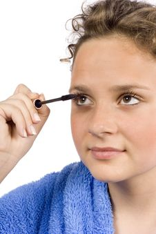Young Woman Dressed Blue Bathrobe Putting Mascara Royalty Free Stock Image