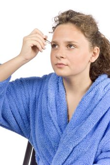 Free Young Woman Dressed Blue Bathrobe Using Tweezer Royalty Free Stock Images - 1371379