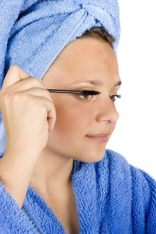 Free Young Woman Dressed Blue Bathrobe Putting Mascara Stock Images - 1371414