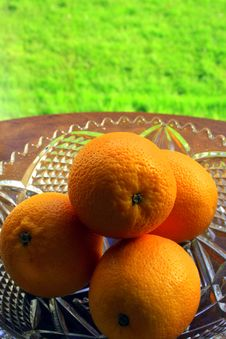 Free Four Oranges In A Crystal Bowl Royalty Free Stock Photography - 1373897