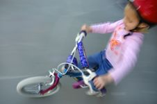 Free Little Girl Biking Royalty Free Stock Image - 1374076
