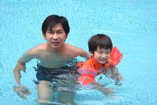 Free Man & Boy In The Pool Stock Photo - 1377520