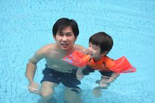 Free Man & Boy In The Pool Royalty Free Stock Image - 1377566