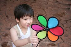 Free Boy & Colorful Windmill Royalty Free Stock Photography - 1377677