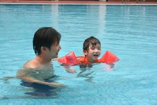 Free Man & Boy In The Pool Stock Images - 1377804