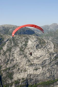 Free Paragliding Over Mountains Stock Images - 1378434