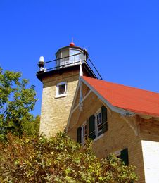 Lighthouse Nestled In Trees Royalty Free Stock Images