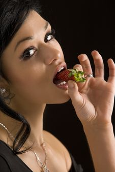 Free Girl Eating A Strawberry Stock Images - 13700824
