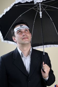 Free Unemployed Man Staying Under Umbrella Stock Photo - 13701000