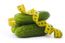 Cucumbers With A Measuring Tape Royalty Free Stock Photography