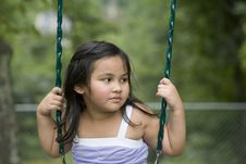 Asian Girl In Swing Royalty Free Stock Images