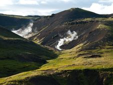 Steaming River, Black Lava Mountains And Sheep In Stock Images