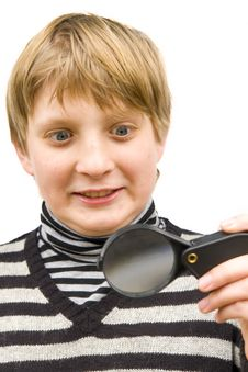 A Boy And A Magnifying Glass Royalty Free Stock Images