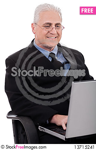 Free Mature Business Man In Working With Laptop Stock Image - 13715241