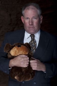 Free Businessman Clutching A Teddy Bear Stock Images - 13713764