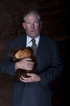 Free Businessman Clutching A Teddy Bear Stock Images - 13714034