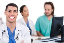 Free Happy Young Doctor In Focus, Two Other Stock Photos - 13714773