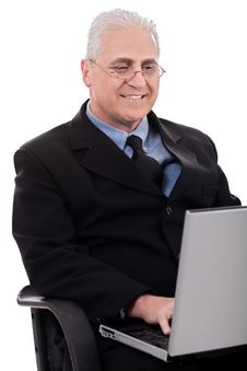 Mature Business Man In Working With Laptop Stock Image