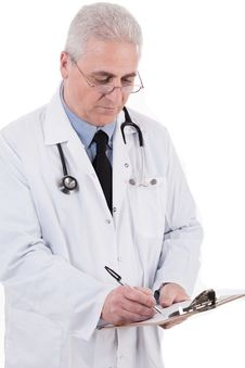 Free Portrait Of Senior Doctor Writing Reports Royalty Free Stock Image - 13715336
