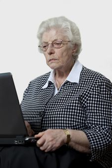 Free Old Woman Concentrated With Her Laptop Stock Photos - 13718033