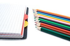 Notebook With A Spring And Pencils Stock Photos