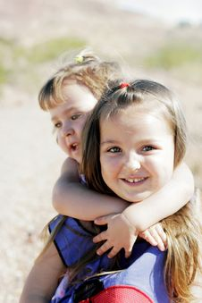 Happy Sisters & A Piggyback Ride Stock Image