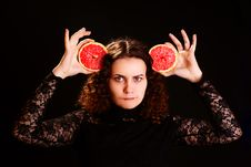 Woman With Grapefruit. Royalty Free Stock Photo